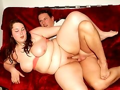 Cute plumper Esther shows off her big fat knockers to lure a hunk into fucking her muff
