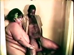 Big fat ample black bitch loves a hard black cock between her lips and gams