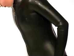 Dressing in beavertail wetsuit & knee shoes, wearing black latex catsuit