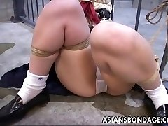 She is tied up to the jail cell and toy nailed