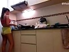First-timer Asian Girl Strips naked while cooking in her kitchen