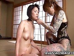Tattooed up Asian domina string on fucking the sub