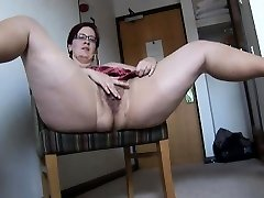Big-titted mature BBW in pantyhose and mini miniskirt