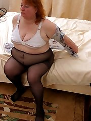 Really big plump posing in black pantyhose