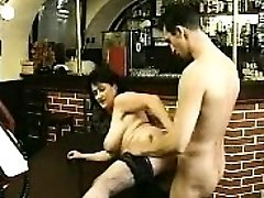 Dark-haired in stockings sucks big cock and penetrates it