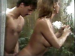 Classic huge-boobed porn queen sucks huge cock in the douche then screws