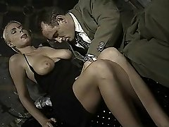 Italian babe does bootie-to-mouth in this vintage clip