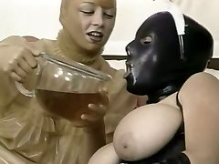 Two wild nymphs in latex outfit lick each other snatches in 69 style