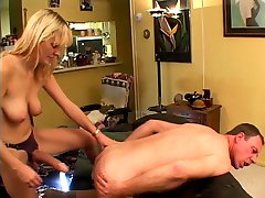 Dude plays with c-cup blonde's clit then sucks and gets fucked by her strap-on