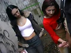 A guy jerked by 2 girls outdoor CFNM