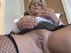 Busty mature blonde secretary in fishnet stockings and tight skirt