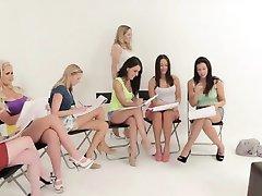 Dressed art students mock nude model