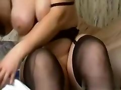 I am this naughty slut with huge amateur tits, who is wearing high high-heeled shoes, while boning a immense black dildo.