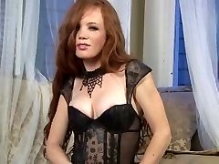 Sexy Redhead in stockings & high stilettos