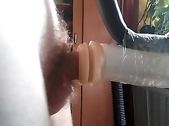 Guy pulverizes rubber vagina