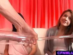 Gals measure dick in penis pump during CFNM show