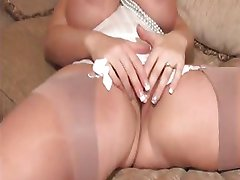 Chubby blonde with big tits strips and plays