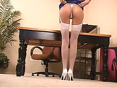 Brunette in stockings and heels spreads legs on chair