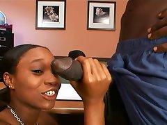 Ebony hottie banged by a big black cock