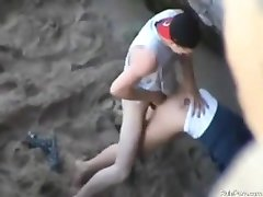 Couple fucking on public beach