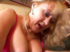 Hairy big tit blonde takes a pounding