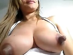 Hefty nipples on milk filled breast