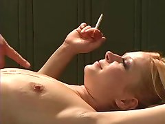 Smoking Blonde does doggie style