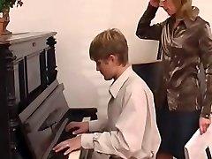piano teacher dominates her schoolgirl