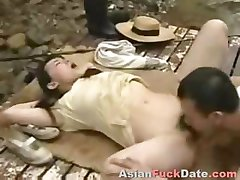 Horny Chinese husband and wife duo get frisky in the woods