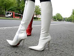 hooker waiting a john in designer patent leather boots