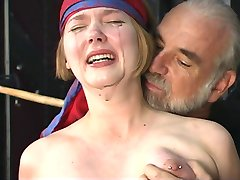 Cute young blonde with perky tits is restrained for nipple clamp play