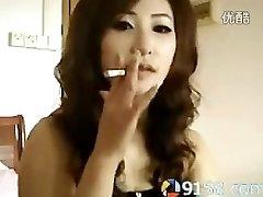 cute chinese woman smoking