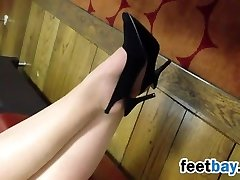 Pale Feet And Black High Heels