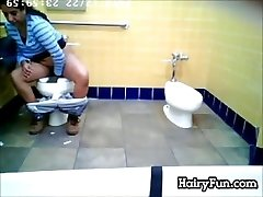 Fat Indian Pissing On A Restroom