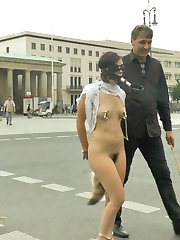 Juliette March looks so cute when she is punished and publicly humiliated.  This pint sized cunt is willing to do anything for Steve Holmes' dick.  Blindfolded, barefoot and exposed to hundreds of onlookers.  Tourist gasp as Steve reveals Juliette's hairy pussy.  Steve continues the spectacle at Juliette's expense by bending her over and caning her perfectly plump ass.  Juliette turns beat red when Steve takes off her blindfold to show her how disgusted people are by her.  Juliette makes the most beautiful pleading face as Steve beats her perfect ass in an attempt to discipline her.  Finally, Steve decides to test Juliette's desire for his cock by taking her to a classy bar to see what she will do.  Steve opens Juliette's filthy holes for small group of voyeurs to see.  Stripped naked Juliette begs for Steve to jam his cock into every one of her holes.  Bouncing up and down on Steve's dick, Juliette's pussy juices stream down his balls as everyone in the bar stares at her dripping gash.  Juliette rubs her cunt and meets the onlookers' eyes, imagining what their cocks look like.  At last Juliette is rewarded with Steve's cum by slurping his balls until they unload all over her face and perky titties.