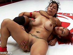 Daisy Ducati has started season 11 off with style. She's currently undefeated in the singles matches. She was also very impressive in her tag matches for season 10 when she filled in for Audrey Rose who had to drop off of team dragon last minute. She has met Izamar on the mats during the tag matches before. Today we get to finally see them go at it One on One. Daisy has some impressive skills and is able to reverse holds on our experienced and strong, Izamar Gutierrez. But this is Daisy's second singles match and she just might not have enough experience to take out one of our best. Pussy's are wet in this match. Daisy and Izamar get so turned on they both nearly cum on the mat.
