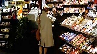 A Dame Visits A Sex Shop To Observe Porn