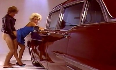 Blonde chick pummeling superb by the car