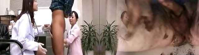Asian nurse and doctor in latex gloves miking patient