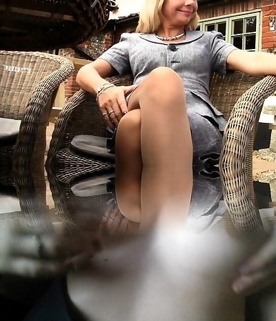 Blonde womens feet and legs in sexy sheer pantyhose Mature Nylon Feet Look Steamy In Milf And Nylons Section