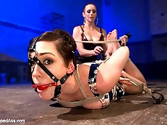 Lily LaBeau returns in an explosive sadistic dungeon scene with Bella Rossi on top. Lily suffers beautifully at the hands of her cruel lezdom mistress in restrictive bondage taking humiliation, spanking, whipping and caning. She's made to lick Bella's gorgeous round ass and has uncontrollable orgasms ripped from her cunt when Bellas decides to fuck Lily's asshole too, taking an anal pounding until she can't cum anymore.