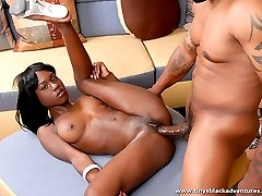 Ebony chick gets bent over by a well endowed black stud