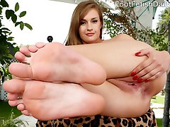 April has fallen asleep with her boyfriend around. He can't get enough of her sexy feet in his mouth. She wakes up and needs his cock. She strokes it with her lovely feet and begs him to fuck her. When he is ready to cum he blasts his load all over her soles.