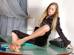 Randy secretary in shiny pantyhose jamming her rubber lover with her feet