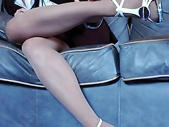 Lewd business-girl in velvety hose going for pussy-stroking and feet-fondling