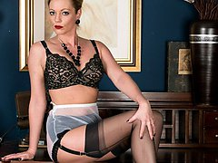 Holly looking stunning in black lingerie ff stockings and black and white heels under her demure...