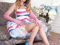 Stella is off to the debutantes ball and looks lovely as she strips and plays in her sexy vintage nylons and lingerie!