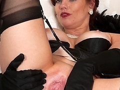 Sophisticated, redhead Holly in black lingerie and ff nylons!