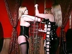 Dominatrix Mistress Erzsebet manhandles her slaves breasts and restrains them in this BDSM porn...