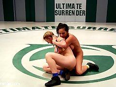 Darling is an experienced Ultimate Surrender wrestler who trains multiple disciplines when she\'s not on our mats. Adrianna Luna is an experienced MMA fighter with big dreams of showing porn sluts how real MMA fighters bang it out! Little does Adrianna know that Darling trains more than your average porn slut and knows our rules inside and out. Darling uses her mouthpiece to do some of the most memorable on-the-mat trash talking we\'ve ever heard from her. It\'s clear she really enjoyed dominating this particular gal especially since Darling sways away from her tried and true technique of catch and release before the 1:30 mark. In this match we get some rare submissions done by our Grappler, Darling. She hardly ever goes for submissions but she had something to prove today. She pulled out all the stops against this MMA babe. This match isn\'t even close. Darling even finds a new ways to score style points in making her opponent worship her muscle while she immobilizes her.  As if submitting to muscle domination and losing at a competitive wrestling match to a \